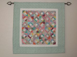 My friendship quilt. Each cream square is signed by a friend.
